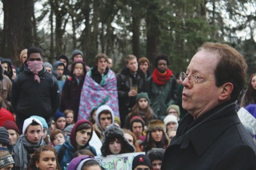 Lewis and Clark President Barry Glassner addresses a large crowd of students who rallied against racism on Friday during a protest on the southwest Portland campus