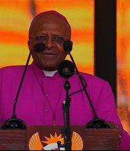 Archbishop Emeritus Desmond Tutu gives the last benediction to close out Nelson Mandela's public memorial on Tuesday, December 10, 2013.