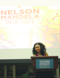 Samantha Dewar, president of the GW Caribbean Student Association, offers remarks about the late Nelson Mandela and leads a moment of silence at the organization's annual holiday dinner on Saturday, Dec. 7.