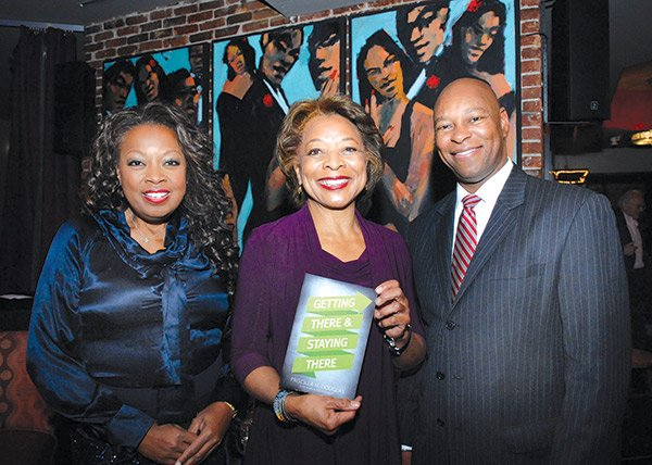 "(l-r) TV personality Star Jones, executive coach and author Priscilla H. Douglas and Darryl's Corner Bar & Kitchen owner Darryl Settles at the launch of Douglas' new book ""Getting There & Staying There."" The event, held at Darryl's Corner Bar, featured a discussion and question and answer session with Douglas moderated by Jones."