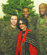 Sylvia Alston (center) with four U.S. Marine Corps servicemen