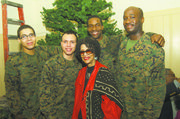 Sylvia Alston (center) with four U.S. Marine Corps servicemen