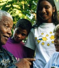 "CNN iReporter Jose Maria de Sacadura Botte shares these photos of their son, Stefano, with Mandela as a young boy. ""Stefano is 18 now and has Mandela quotes on his bedroom walls for some time and I know that he has made a difference in our sons life even though he most likely does not remember that day spent with one of the world's greatest persons."""