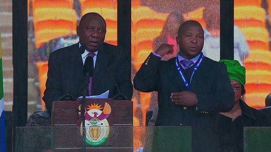 The sign language interpreter widely ridiculed for his performance at the Nelson Mandela memorial stands by his work.