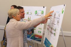 Clarkston residents Kitti Murray and Doug Guess discuss streetscape ideas cpatured on display boards from engineering and consulting firm AMEC.