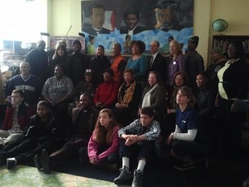 An entourage of volunteers who traveled from cities across the country this week in commemoration of the first anniversary of the Newtown, Conn., shootings, also visited the Children of Mine Youth Center in Southeast on Dec. 12.