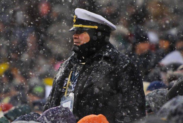 A fan braves the snow and gusty winds during the Army-Navy game at Lincoln Financial Field in Philadelphia on Saturday, Dec. 14.