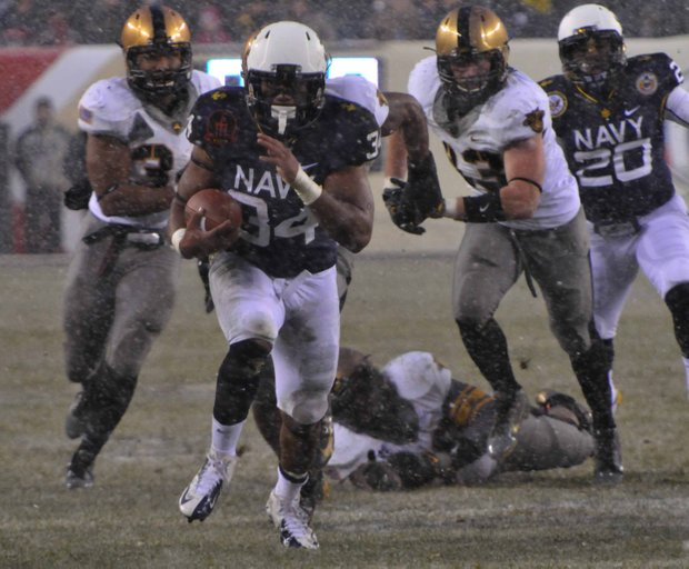 Navy Midshipmen fullback Noah Copeland breaks free for a touchdown run in the second quarter at Lincoln Financial Field in Philadelphia on Saturday, Dec. 14. Copeland ran for 136 yards and three touchdowns in Navy's 34-7 win against the Army Black Knights.