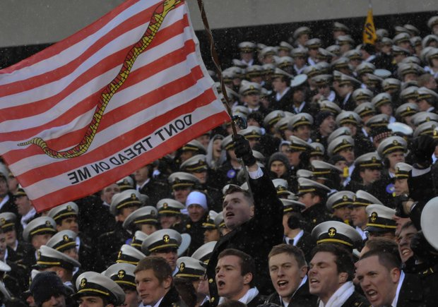 Navy midshipmen wave the First Navy Jack during the Army-Navy football game at Lincoln Financial Field in Philadelphia on Saturday, Dec. 14.