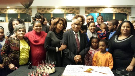 Judge Bolden is surrounded by family members as he gets ready to cut his birthday cake.