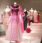 "The Museum of Fine Arts currently has a ""Think Pink"" exhibit on display that gives a historical perspective on how the color pink has shaped fashion and American culture. On display are items including dresses, above, hats, lingerie and shoes."