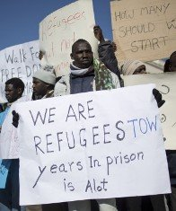 some 200 African migrants crossed 60 miles by foot over two days in winter weather to rally at the Israeli ...