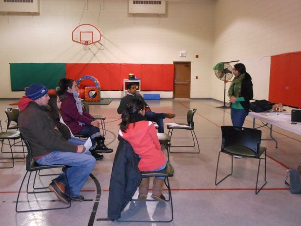 Enroll America organizer Sakina Tayebali talks to a group about the Affordable Care Act at the Spanish Community Center in Joliet on Saturday
