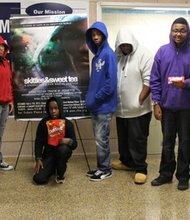 """For the performance of """"Skittles & Sweet Tea: a choreopoem for social justice,"""" these students from ConneXions, a community based arts school in the Greater Mondawmin area dressed in hooded sweatshirts """"hoodies"""" and some held packages of Skittles candy reminiscent of Trayvon Martin. ConneXions aims to cultivate academic and artistic excellence, cultural identity and community awareness in its students."""