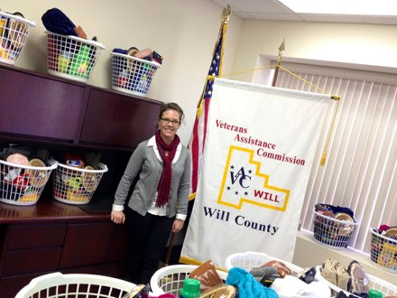 Kristi McNichol, superintendent of the Will County Veterans Assistance Commission, is surrounded by baskets of gifts that were donated for area veterans.