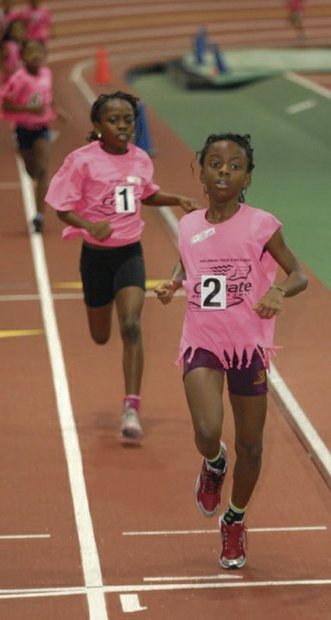 Elementary students competing in track meet
