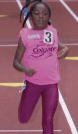 Preteen elementary school girls competing at the Armory track