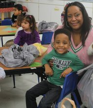 St. Jerome Head Start students Tristin and Kelli with Epsilon Omega member Shaletta Espie