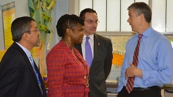 From left: Jesús Aguirre, the acting chief administrator at the Office of the State Superintendent of Education, exchanged views during a gathering with educator Shantelle Wright, D.C. Mayor Vincent Gray and U.S. Secretary of Education Arne Duncan. (Courtesy of Office of the State Superintendent of Education)