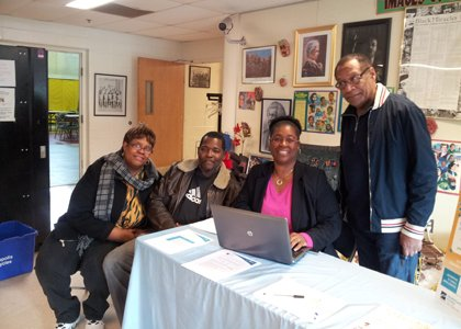 Annapolis residents Joyce and Kenell Hunt along with Alease Kouadio, certified navigator, Chatman, LLC and James Turner, facility manager for the Stanton Center in Annapolis.