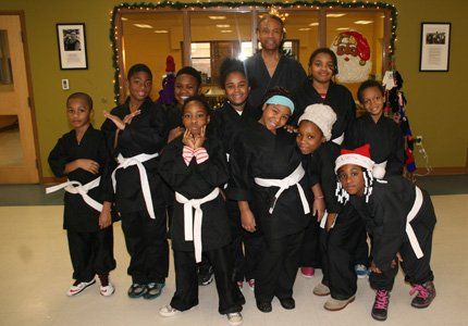 Baltimore City Orphans' Court Judge Lewyn Scott Garrett has volunteered for 17 years as a karate instructor at the John Eager Howard Recreation Center. Garrett awarded karate uniforms to 11 students who successfully completed his class this session during the Christmas celebration at the center. These youths are 10 of his top karate students.