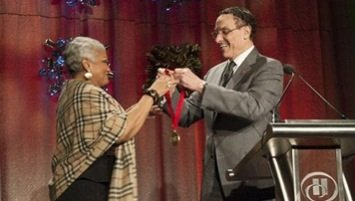D.C. Mayor Vincent Gray presented Barbara Lang, president and CEO of the DC Chamber of Commerce, with the D.C. Medal of Honor at a Dec. 12 luncheon.