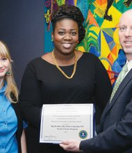 Kevin Rickett (from left), special agent in charge of the FBI in Oregon, presents a leadership award to Chabre Vickers and Tami Wallis of Big Brothers, Big Sisters on behalf of the non-profit group's mentoring program for children.