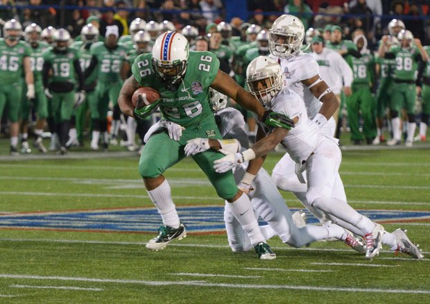 Marshall tight end Gator Hoskins barrels through Maryland defenders in the 2013 Military Bowl on Friday, Dec. 27 at Jack Stephens Field at Navy-Marine Corps Memorial Stadium in Annapolis. The Thundering Herd defeated the Terrapins, 31-20.