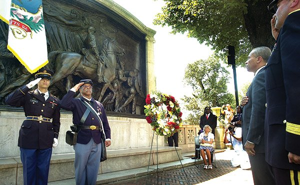 The 150th anniversary of the first black Union regiment's attack on Fort Wagner in South Carolina was celebrated at the State House in Boston on July 18. Among the speakers was Gov. Deval Patrick, who laid a wreath in front of the Robert Gould Shaw Monument, dedicated to the memory of the 54th Regiment. Seated center is Winifred Monroe, the only living granddaughter of Henry Monroe, who was a 13-year-old drummer boy on that fateful day.