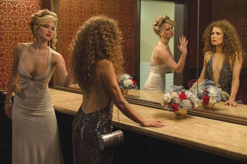 Jennifer Lawrence (left) stars as Rosalyn Rosenfeld, and Amy Adams as Sydney Prosser in American Hustle.