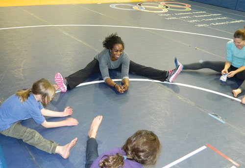 Gymnist Saidah Wilson introduces acrobatics and tumbling to local youth.
