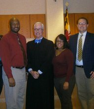(Left to right) Clint Stanley; Lauren Seldomridge; Ashley Aubas; Selwyn Finch; Judge Robert Kershaw; Kandice Polk; Daniel Feller; Gordon James; and Carlton Thomas are eight of ten CASA volunteers sworn in recently. CASA volunteers aid in the transition from the foster care system to a safe permanent home, giving hope and support to Baltimore's children.