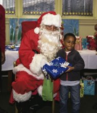 Preschooler enjoyed gifts from Federation of Protestant Welfare Agencies.
