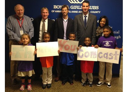 The Boys & Girls Clubs of Annapolis recently received a $20,000 grant from the Comcast Foundation to support their Club Tech program. Pictured (l-r) Pete Ponne, board member and Interim Chief Professional Officer, Boys & Girls Clubs of Annapolis & Anne Arundel County; Chris Comer, Director, Government Affairs, Comcast; The Honorable Chris Trumbauer, Anne Arundel County council member; Brad Palazzo, Director, External Affairs, Comcast; and Tierra Snowden, Director of Program Operations, Boys & Girls Clubs of Annapolis & Anne Arundel County with children from the club.