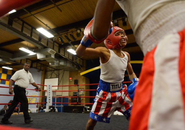 Kesean Bagwell attacks Lawrence Malcolm in the corner in the second round of a three-round bout at the District Heights Classic, an annual amateur boxing event, at the District Heights Municipal Center on Saturday, Jan. 4. Bagwell won the fight by decision.
