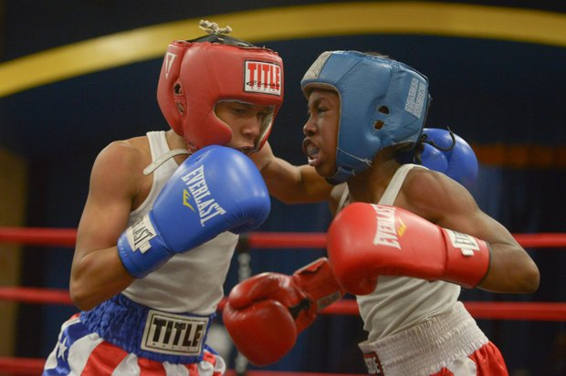 Kesean Bagwell (left) and Lawrence Malcolm go head to head during their boxing match at the District Heights Classic, an annual amateur boxing event, at the District Heights Municipal Center on Saturday, Jan. 4. Bagwell won the fight by decision.