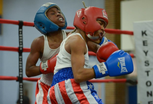 Lawrence Malcolm (left) lands a left hook against Kesean Bagwell in the second round of their boxing match at the District Heights Classic, an annual amateur boxing event, at the District Heights Municipal Center on Saturday, Jan. 4. Bagwell won the fight by decision.