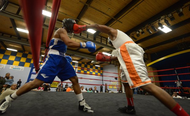 Davon Boone (right) lands a punch against Gary Jones in the first round of their boxing match at the District Heights Classic, an annual amateur boxing event, at the District Heights Municipal Center on Saturday, Jan. 4. Boone won the match by decision.