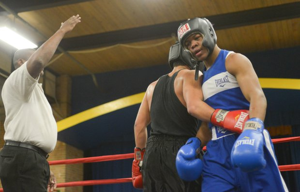 Tommy Avezar congratulates Gary Antwon Russell after their three-round amateur boxing match at the District Heights Classic, an annual amateur boxing event, at the District Heights Municipal Center on Saturday, Jan. 4. Russell won the match by decision.