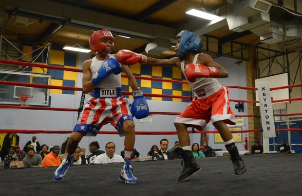 Kesean Bagwell (left) dodges a punch by Lawrence Malcolm in the first round of a three-round bout at the District Heights Classic, an annual amateur boxing event, at the District Heights Municipal Center on Saturday, Jan. 4. Bagwell won the fight by decision.