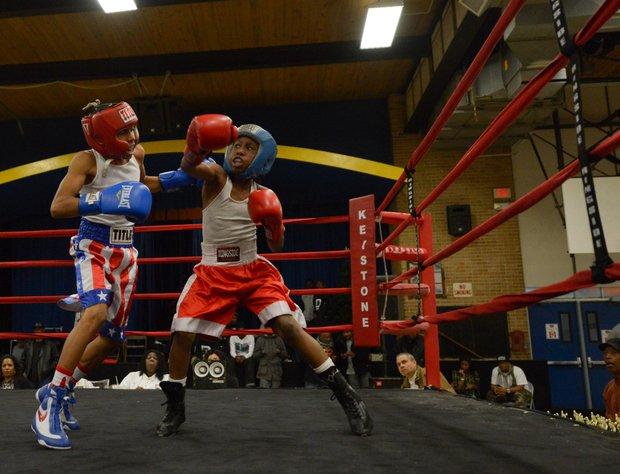 Kesean Bagwell (left) readies a left hook against Lawrence Malcolm in the first round of a three-round bout at the District Heights Classic, an annual amateur boxing event, at the District Heights Municipal Center on Saturday, Jan. 4. Bagwell won the fight by decision.