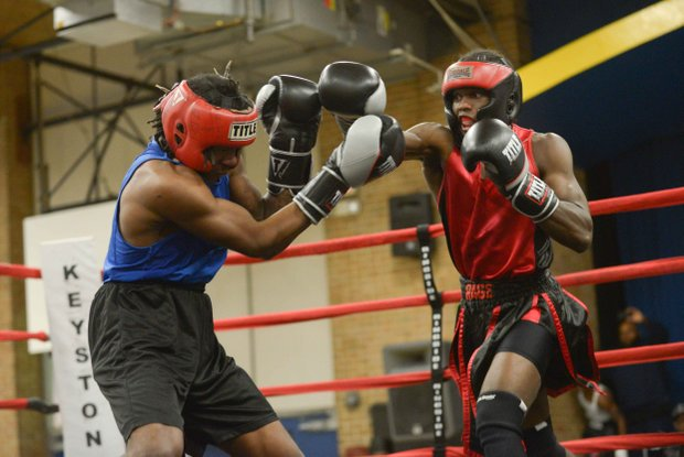 Charles Brumfield (right) tries to land a right hand against Jesse Singletary during a sparring session at the District Heights Classic, an annual amateur boxing event, at the District Heights Municipal Center on Saturday, Jan. 4.