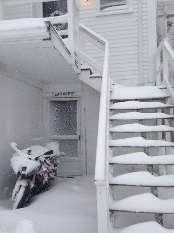 A building in Chatham, Massachusetts on Cape Cod is completely covered in snow on Friday, January 3,