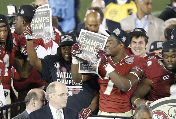 Jameis Winston threw a two-yard touchdown pass to Kelvin Benjamin with 13 seconds to play Monday night to give Florida ...