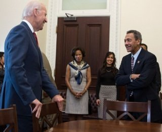 Vice President Joe Biden greets Mel Watt and his family Monday at the White House before ceremonially swearing him in as FHFA Director. (Courtesy of Vice President Biden's office)