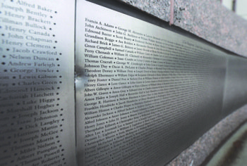 A bullet indentation is visible on the Wall of Honor at the African-American Civil War Memorial after shots were fired on U Street in Northwest in late December.