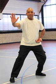 Master Heg Robinson demonstrates the t'ai chi pose Repulse the Monkey.