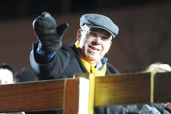 Mayor Thomas M. Menino greets the crowds along Boylston Street that were gathered to see the 2014 First Night procession. Menino's final term in office ended Monday.