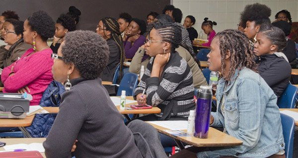 Boston's Natural Hair Meetup members attend an organization event to hear about topics related to natural hair care and styling.