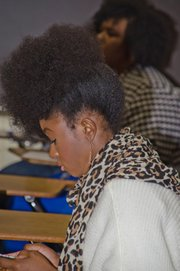 an attendee at a recent events displays her natural hair style.